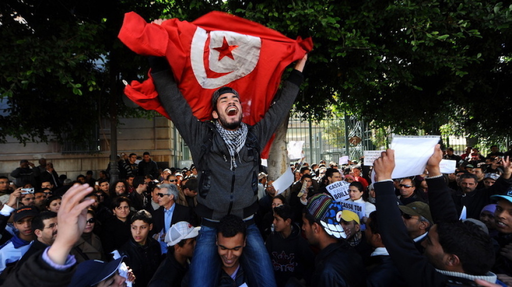 For Tunisian protesters, democracy is not enough